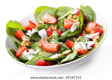 salad with strawberry, spinach leaves and feta cheese on white background - stock photo