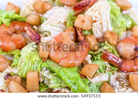 Salad with tiger shrimps and vegetable closeup