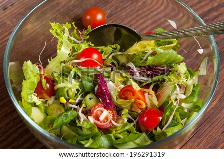 Salad with tomato, cucumber, garlic and olive oil.