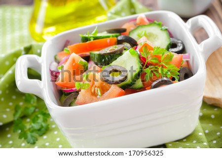Salad with tomatoes and cucumbers - stock photo