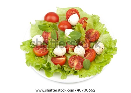 salad with tomatoes and mozzarella isolated - stock photo