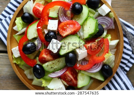 salad with tomatoes and olives, top view - stock photo