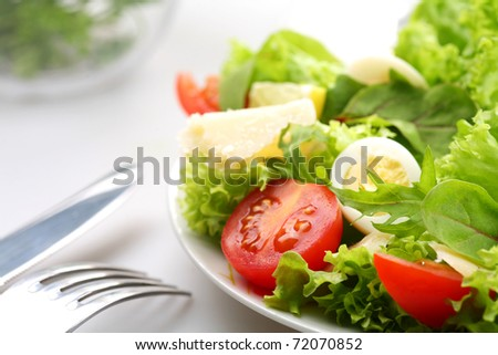 salad with tomatoes and quail egg - stock photo