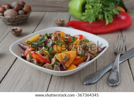 salad with tomatoes, peppers, onions, mushrooms and nuts
