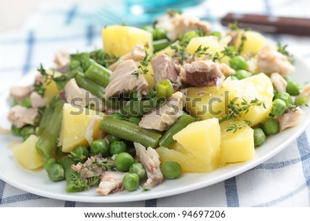 Salad with tuna, boiled potato, steamed green beans, peas, and thyme - stock photo