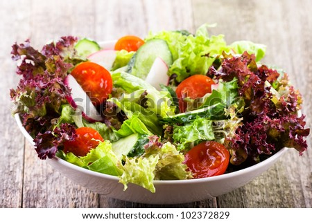salad with vegetables and greens - stock photo