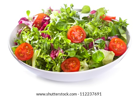 salad with vegetables and greens on white background - stock photo
