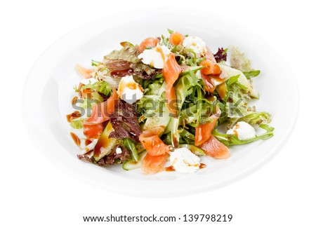 Salad with vegetables,fish and cheese. White background.