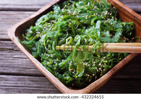 Salad with wakame with chopsticks - stock photo