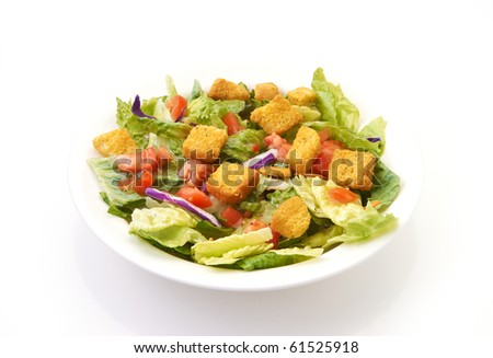 Salad with white bowl on a white background with copy space and reflection