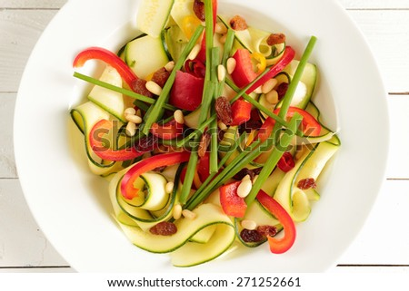 Salad with zucchini, paprika, fresh chive and chicken  - stock photo
