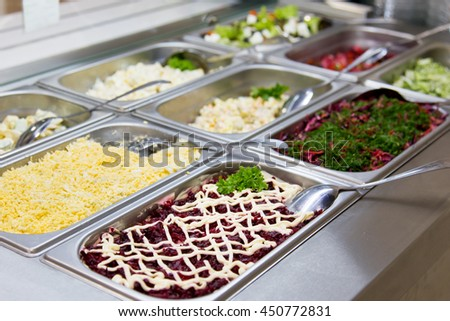 Salads in restaurant on the metal plates. selective focus - stock photo