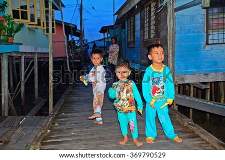 SALAK - JANUARY 23 : Malay children on 23 January 2016 at Salak, Malaysia. Salak is a small Malay fishing village in Borneo full of young kids.