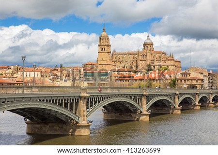 Salamanca - The Cathedral and bridge Puente Enrique Estevan Avda and the Rio Tormes river.