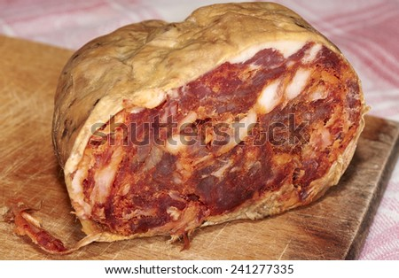 Salame brawn, typical product spicy Calabrian natural of pork meat with spicy chili and natural flavors - stock photo