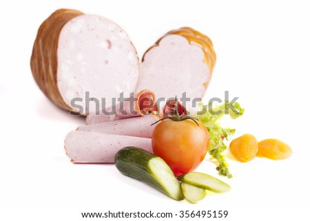 Salami and some vegetables isolated on white background - stock photo
