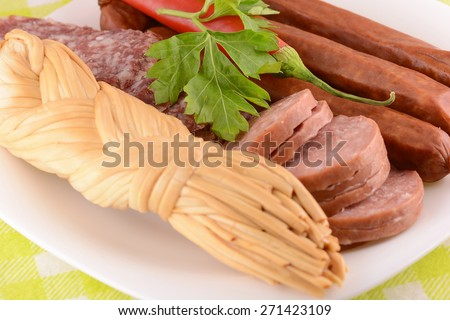 salami, cheese and red pepper, toast with melted cheddar cheese and dry sausages slices, close up - stock photo