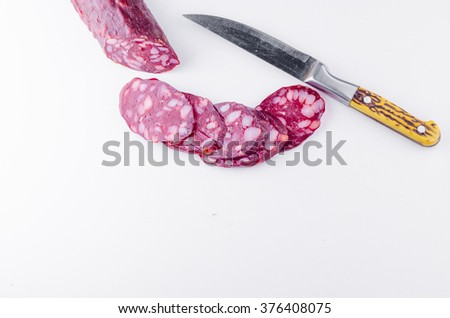 salami isolated on a white background - stock photo