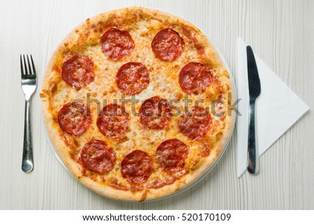 Salami pizza on the table
