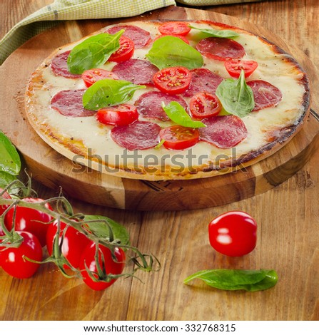 Salami Pizza served on a wooden table. Selective focus