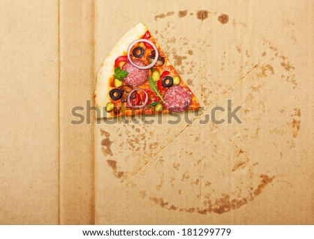 Salami pizza slice over box. - stock photo