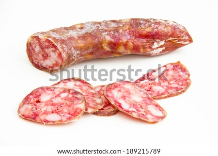 Salami with slices on white background