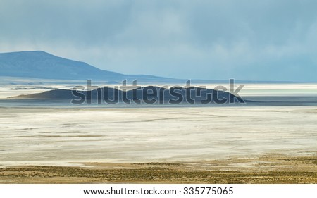 Salar de Coipasa on the border of Chile and Bolivia viewed from Chile. - stock photo