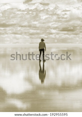 Salar de Uyuni is largest salt flat in the World (UNESCO World Heritage Site) - Altiplano, Bolivia, South America (stylised retro) - stock photo