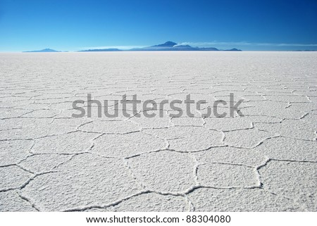 salar de uyuni salt desert in sunlight in bolivia - stock photo