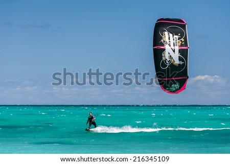 SALARY, MADAGASCAR, JUN 6: An unidentified kitesurfer surfing in the lagoon of Salary, Madagascar on june 6, 2010 - stock photo