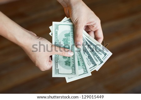 salary, money in hands - stock photo