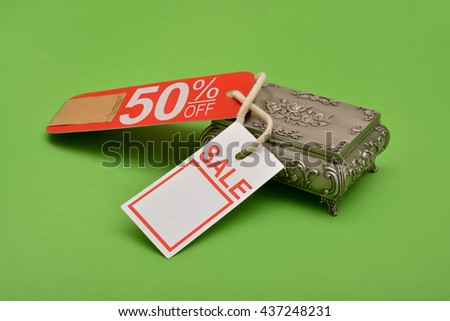 Sale Banner Tag with secret box on green background - stock photo