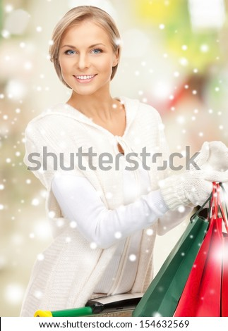 sale, christmas, x-mas and holidays concept - lovely woman with shopping bags