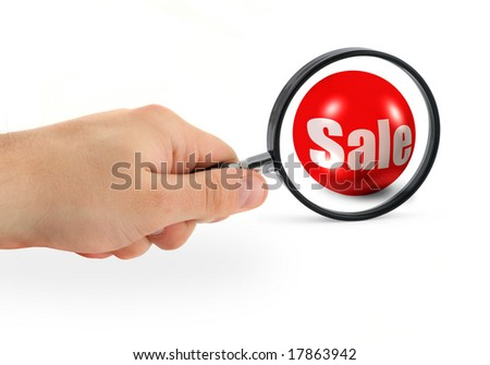 sale concept - hand with magnifying glass