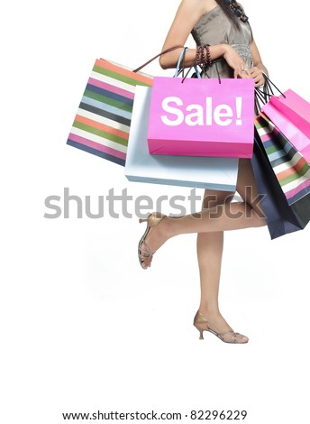 sale concept. woman with a shopping bags isolated on white - stock photo