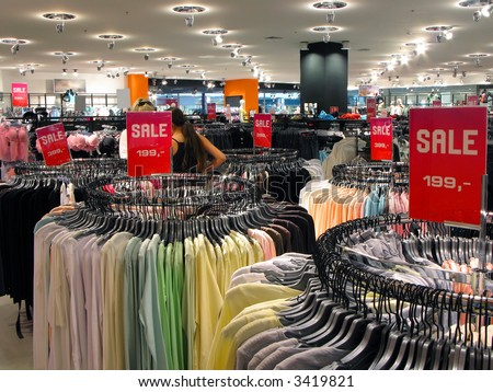 Sale in fashion wearing shop - stock photo