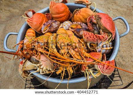 Sale of cooked seafood on the beach in Nha Trang. Vietnam - stock photo