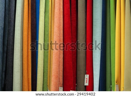 Sale of many different vibrant textile fabrics - stock photo