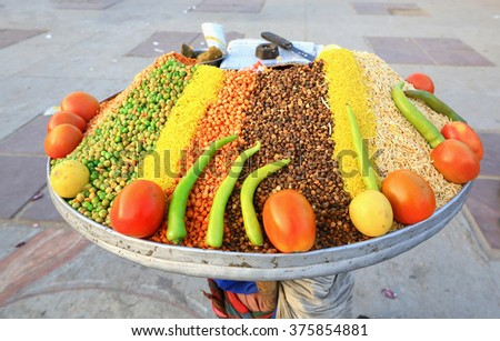 sale of spices on the street, spice tray on her head - stock photo