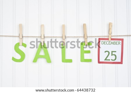 SALE on a Clothesline with a Christmas Calendar Page.  Holiday Concept. - stock photo