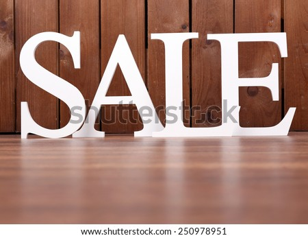 Sale on wooden background - stock photo