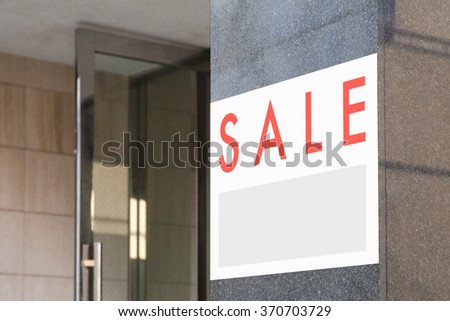Sale Real Estate Sign in Front of building - stock photo