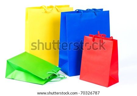 Sale shopping bags red, blue, yellow, green on white background