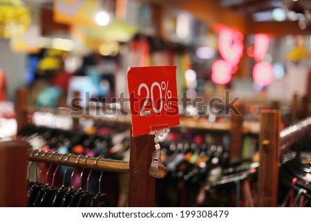 sale sign in a clothing store - stock photo