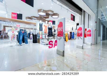 Sale sign in clothes shop - stock photo