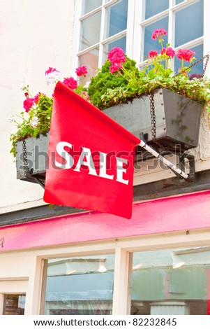 Sale sign on a small boutique shop in England - stock photo