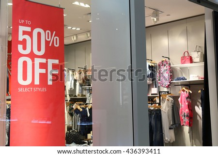 sale sign on cloth store - stock photo