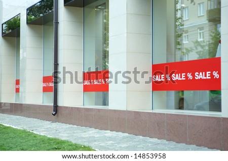 Sale sign on glass window shop - stock photo