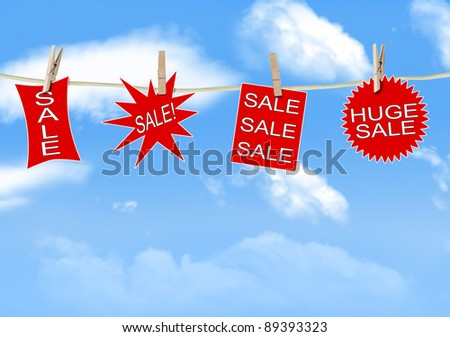 Sale signs hanging on a clothes line - stock photo