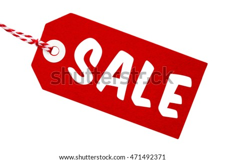Sale tag made from recycled card in red and white with string on an isolated white background with a clipping path